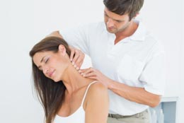 Woman receiving chiropractic